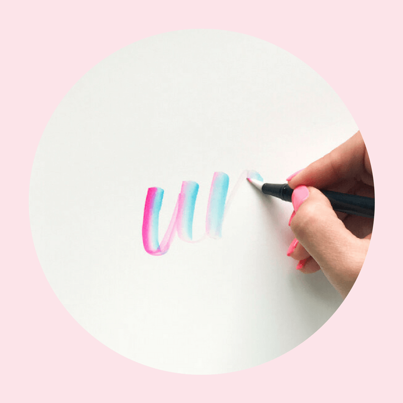 Learn how to create two color blended unicorn lettering within a single brush marker stroke using your Tombow Blended Dual Brush Pen (N00) with this free video tutorial and supply list from amandaarneill.com